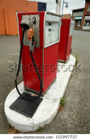 Old Gas Pump. Abandoned old fuel pumps at a service station.  - stock photo