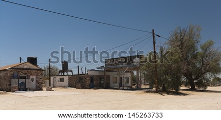 Old gas station in ghost town along the route 66 - stock photo