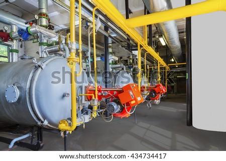 Old gas steel boilers established in old  boiler-house - stock photo
