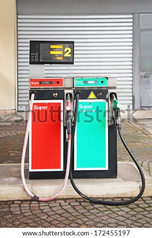 Old Gasoline pump on a petrol station - stock photo