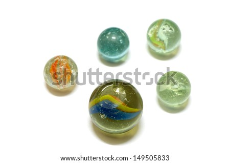 old glass marble balls and broken isolated on white background - stock photo