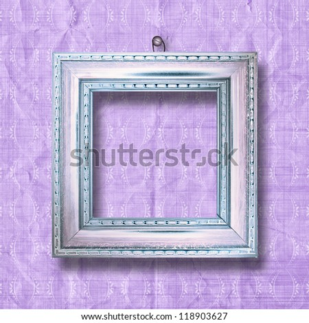 Old gold frames Victorian style on the wall in the room - stock photo