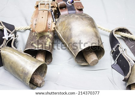 Old golden bells and clapper decoration objects - stock photo