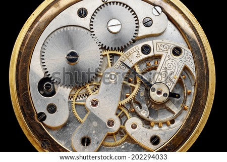 old golden clock machinery - stock photo