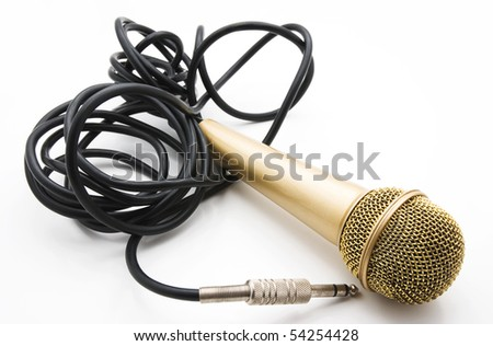 old golden microphone with a black wire - stock photo