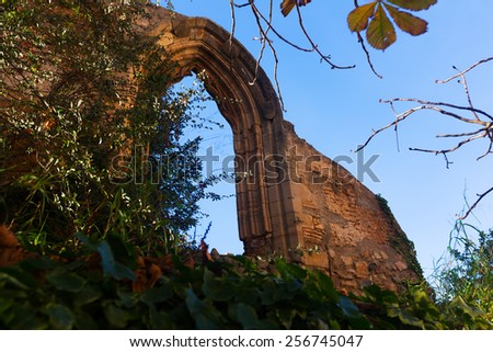 Old gothic arch in abandoned Monastery. Poblet, Catalonia - stock photo