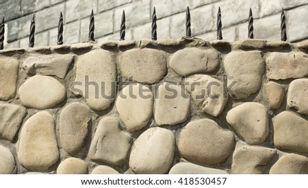old Gothic stone wall of rubble orange - stock photo