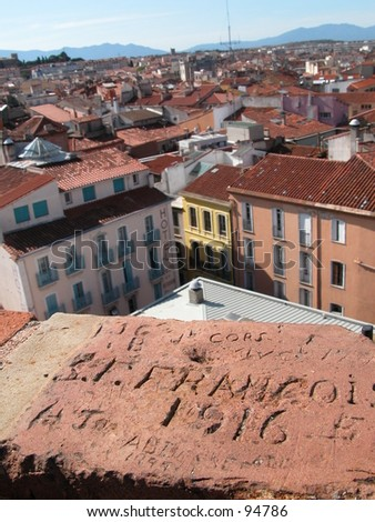 Old grafitti (1916) on a tower overviewing the city of Perpignan in the south of France (vertical) - stock photo