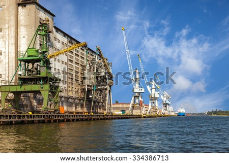 Old grain elevator whit cranes in port of Gdansk, Poland. - stock photo