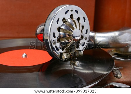old gramophone and vinyl record - stock photo
