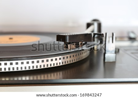 Old gramophone turntable with disc - stock photo