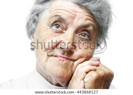 Old grandmother face on white - stock photo