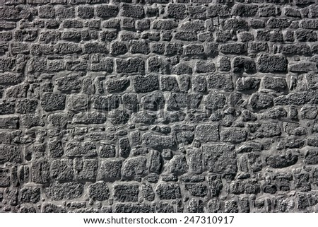 Old granite wall from an european medieval palace - stock photo
