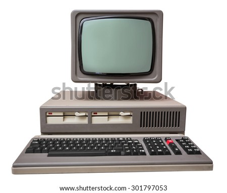 Old gray computer isolated on a white background - stock photo