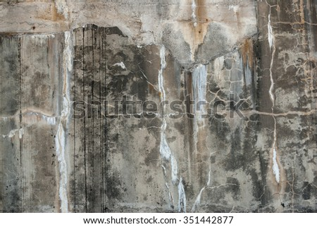 Old gray grunge bunker wall background - landscape layout photograph - stock photo