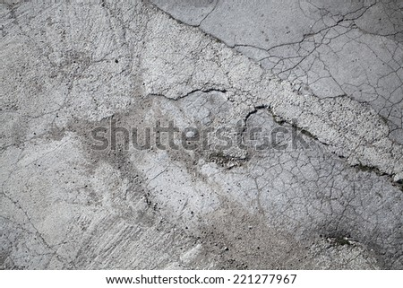 Old gray grungy asphalt road background texture - stock photo