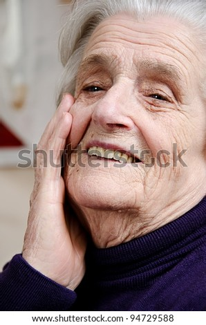Old gray-haired woman - stock photo