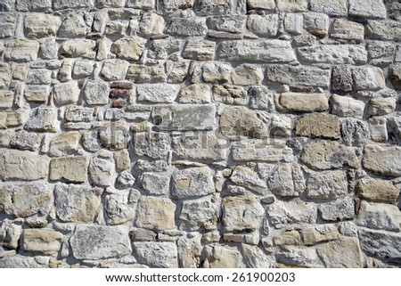 old gray stone wall of brick texture background with space - stock photo