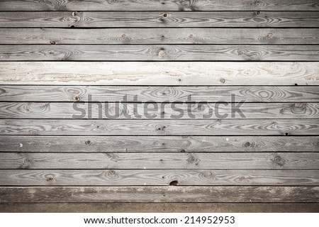 Old gray wooden wall, background photo texture - stock photo