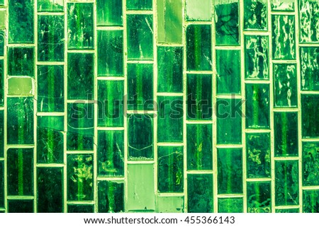 Old green ceramic tile wall - stock photo