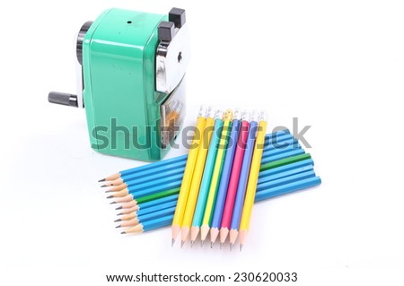old green sharpener and colorful pencil isolated on white background - stock photo