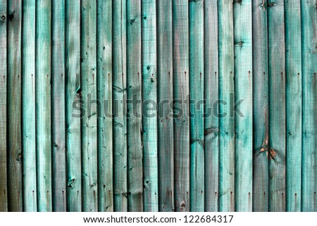 Old Green slatted Wood garden or house Fence - stock photo