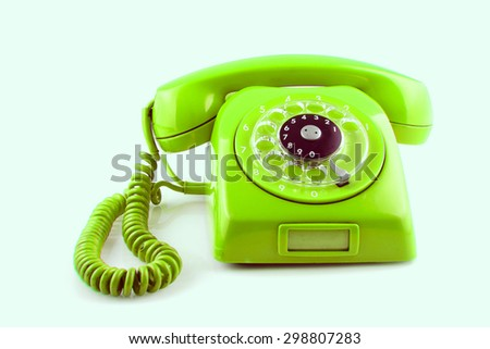 old Green telephone with rotary dial color toned - stock photo