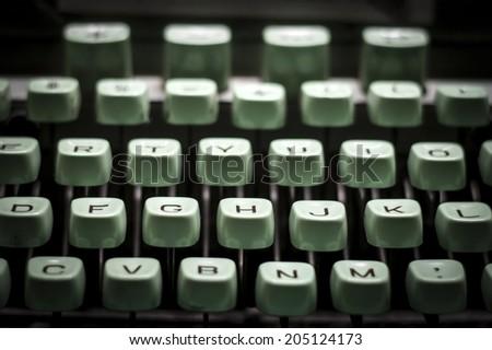 old green typewriter, shaded image,  - stock photo