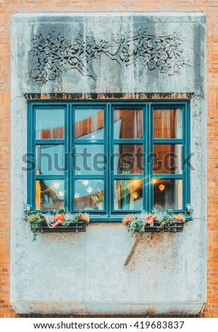 Old green vintage window with decor.  - stock photo