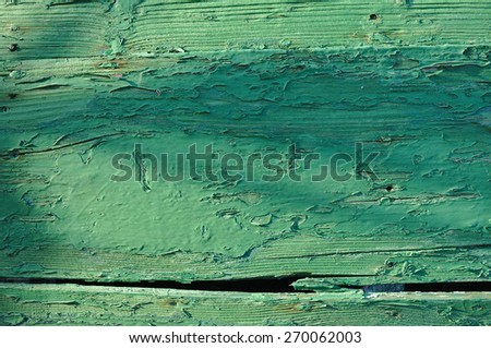 Old green wooden boat hull with paint peeling off. Backgrounds and textures - stock photo