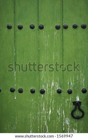 old green wooden door - stock photo