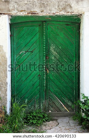 old green wooden door - stock photo