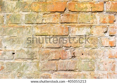 Old grunge brick wall background texture with damp stains and weathered bricks in a full frame view - stock photo