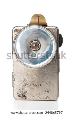 Old grunge flashlight on white background - stock photo