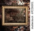 Old grunge interior frame against destroyed wall - stock photo