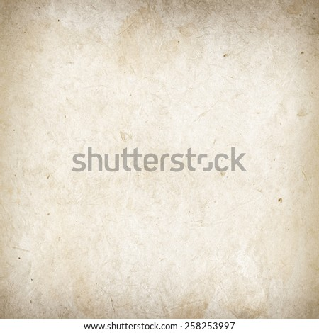 Old grunge paper texture. Background wallpaper - stock photo