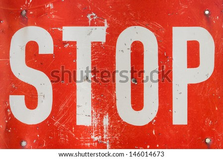 Old grunge STOP sign closeup photo - stock photo
