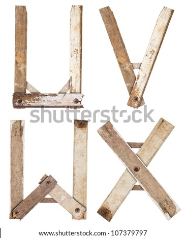Old Grunge Wooden Alphabet, isolated on white background ( u v w x ) - stock photo