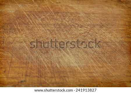 Old grunge wooden kitchen cutting board as background  - stock photo