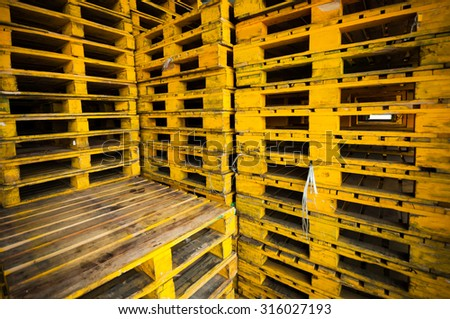 Old grunge yellow wood pallets background. - stock photo