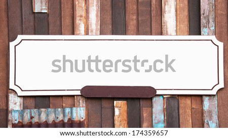 Old grungy antique wooden plank of a sign on string  - stock photo