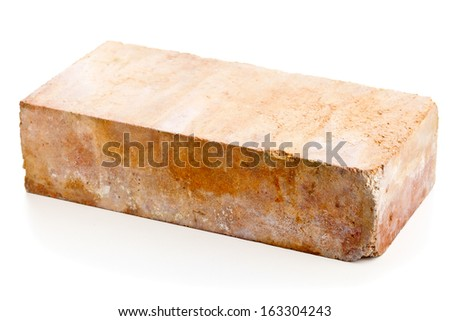 Old grungy clay brick over white background - stock photo