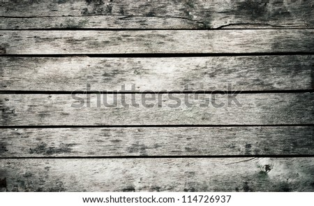 Old grungy grey wooden wall - stock photo