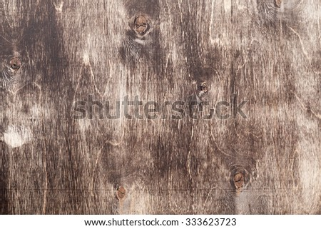 Old grungy plywood with dark brown mordant, background photo texture - stock photo