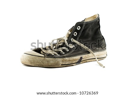 Old grungy sneaker isolated on white background - stock photo