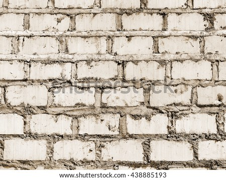 old grungy wall of mixed bricks ,chalk is comming off - stock photo