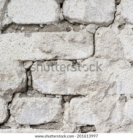 Old grungy white brick wall fragment as an abstract background composition - stock photo