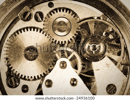 Old grungy wristwatch clockwork close-up - stock photo
