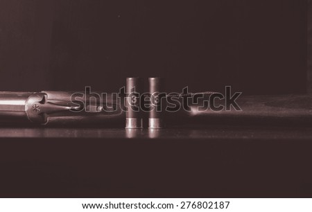 old gun and bullets - stock photo