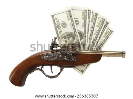 Old gun and hundred dollar bills isolated on white background - stock photo